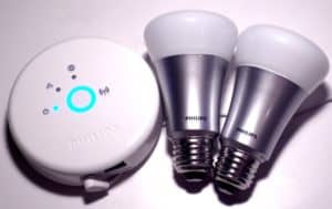 Philips Hue Smart Light Bulbs on the right, with a controller hub on the left.