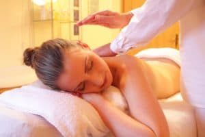 Woman relaxing at a spa, having a back massage