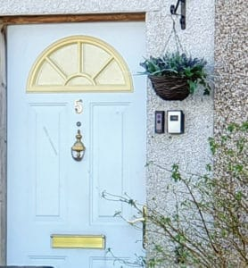 A door with a narrow frame, leading to a Ring doorbell being installed on the wall instead.