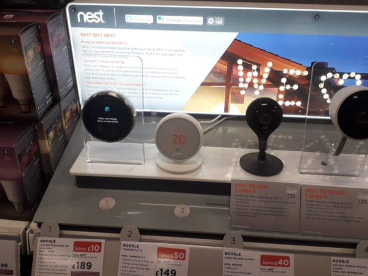 Nest products in store, including the Learning Thermostats and smart security cameras.