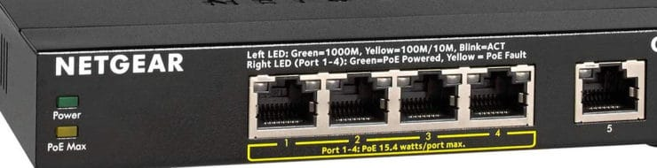 Four powered 'type 1 PoE' Ethernet ports shown on a Netgear GS305P network switch.
