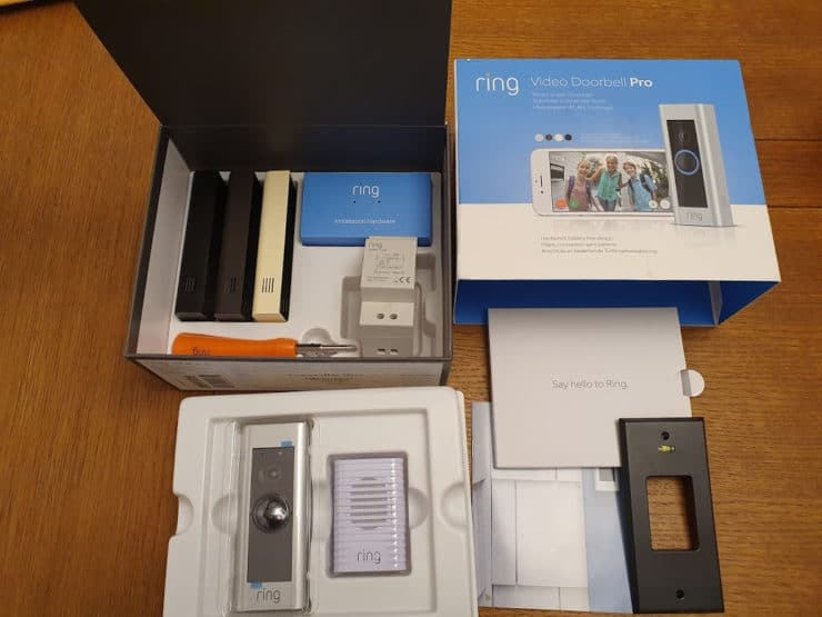 Inside a Ring Doorbell Pro box: showing the doorbell itself, the chime, multiple face plates, transformer, spirit level guide and install instructions.