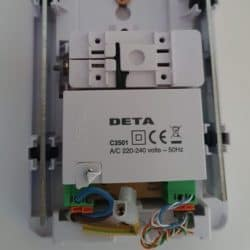 Inside a Deta C3501 mains voltage doorbell: the input (mains voltage) cables are on the bottom left, with the output (CAT5) cables on the bottom right.