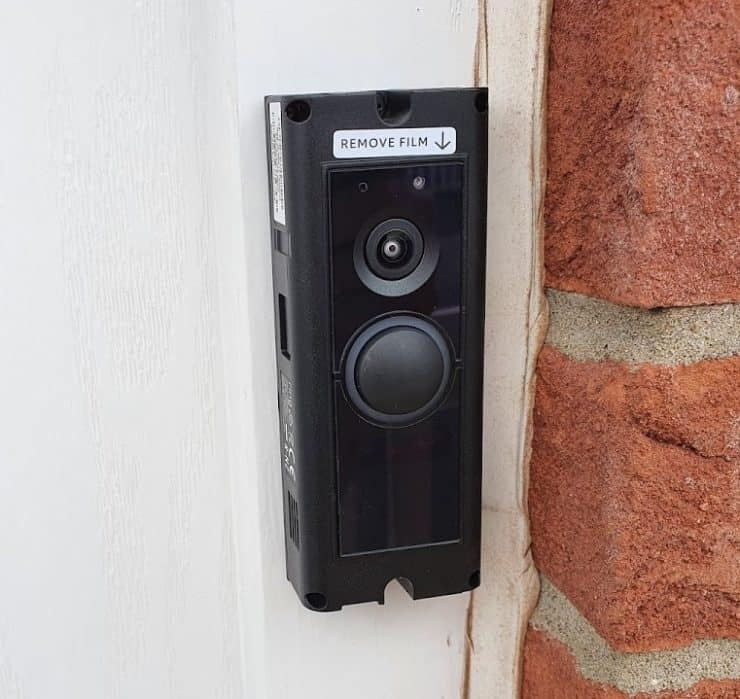 A Ring Pro attached to a door frame, but without the faceplate - or power being supplied to it (yet).