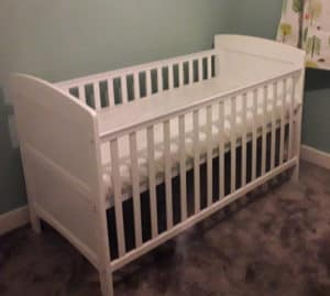 My son's adjustable height cot bed with side barriers.