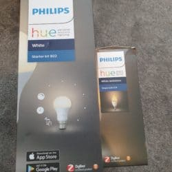 "The boxes for the Philips Hue B22 Starter Kit and the Philips Hue White Ambiance E14 bulbs, both of which say ""ZigBee Certified product"" on their side."