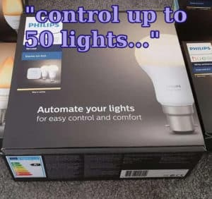 """A Philips Hue starter kit, with the text """"control up to 50 lights..."""" overlayed on it."""