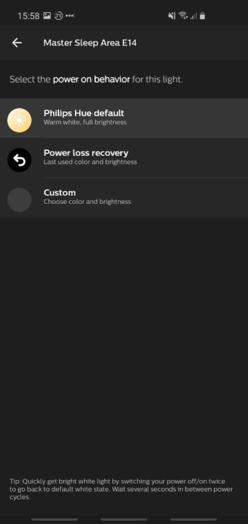 "Screenshot of the Philips Hue mobile app, showing the power-on behavior setting for a bulb. Options are ""Philips Hue Default"", ""Power loss recovery"" or ""Custom""."