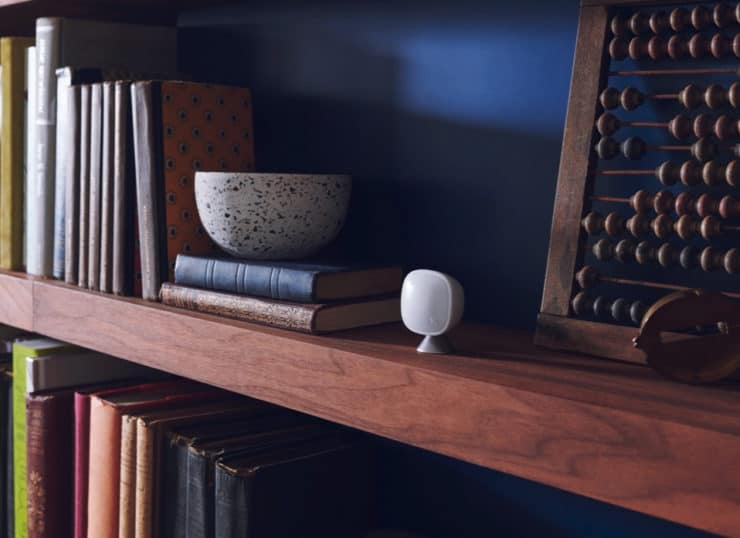 An ecobee room sensor on a bookcase shelf.