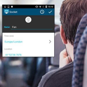 A smart plug phone app on top of a person on a train.