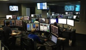 SpaceX staff working in their control centre during a launch, with lots of computer monitors at each desk each