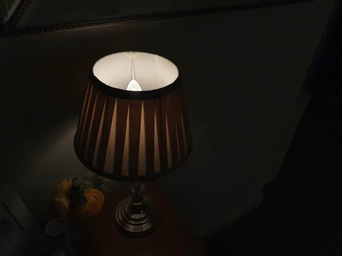 A table lamp with Philips Hue E14 candle bulb, dimmed to 1% brightness