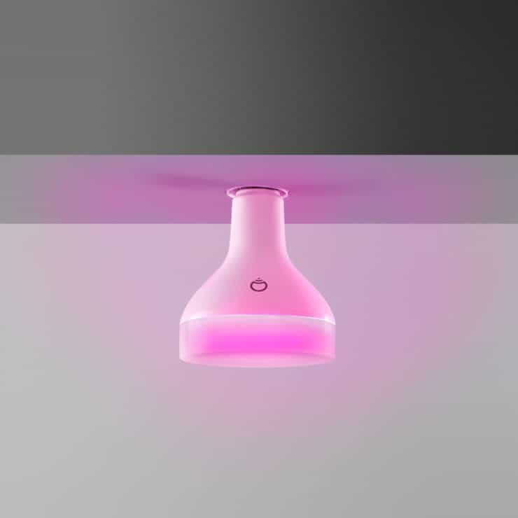 A LIFX BR30 light installed in the ceiling, showing a pink color light.