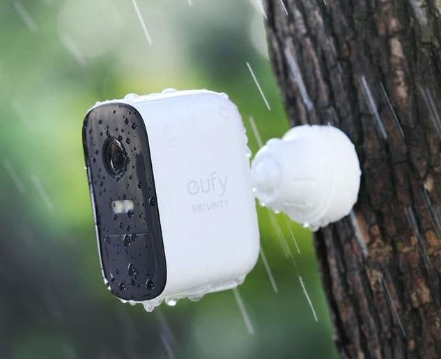 Marketing image of the waterproof eufy camera installed outside when it's raining.
