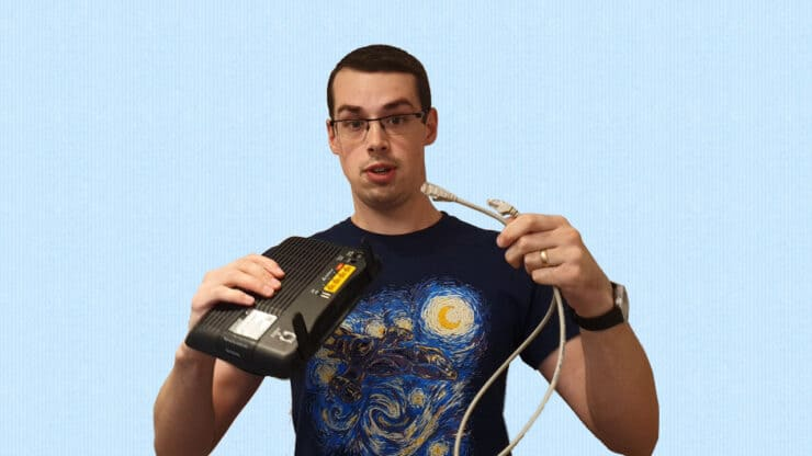 YouTube thumbnail image showing me showing me holding a router and an Ethernet cable.
