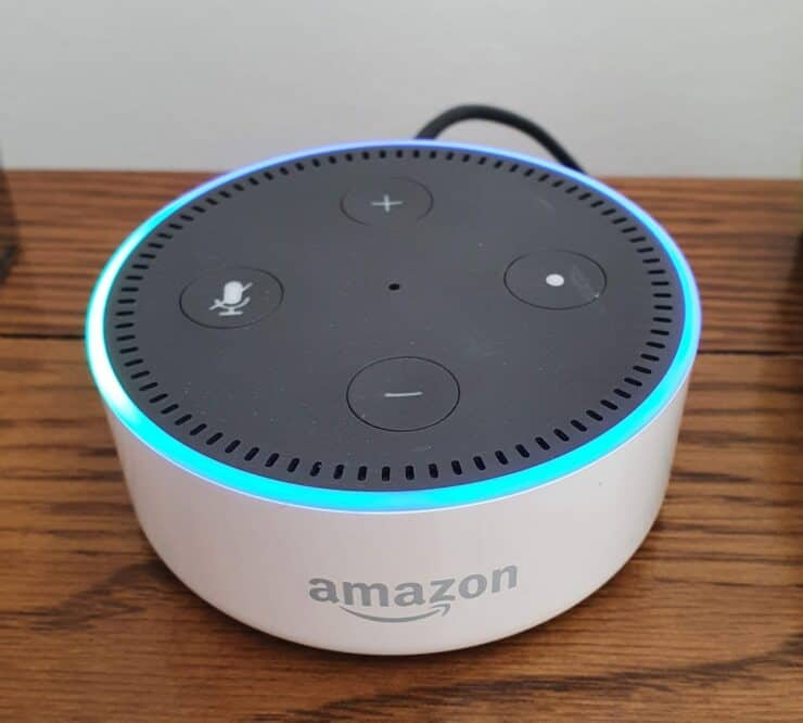"""My white Echo Dot 2nd gen in listening mode after I said """"Alexa"""", denoted by a blue ring on its top."""