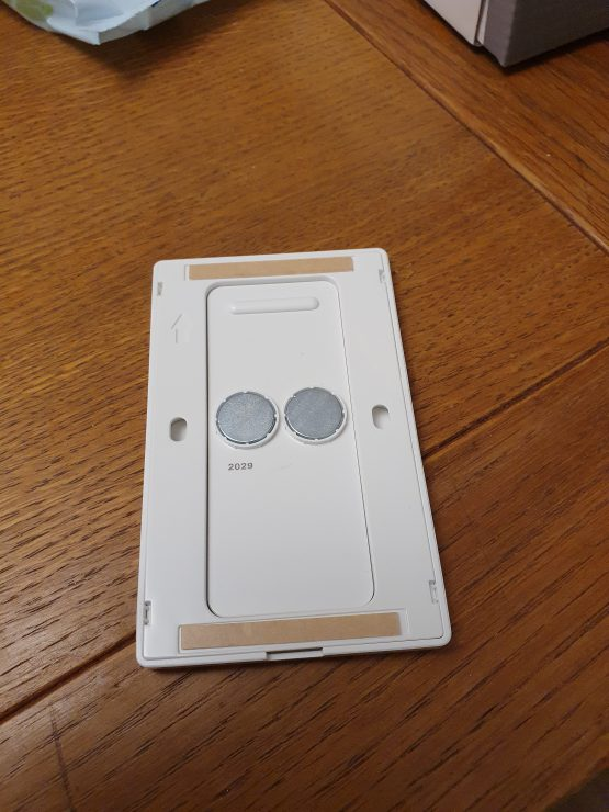 The back of my Philips Hue dimmer switch, with magnets to keep the switch in place