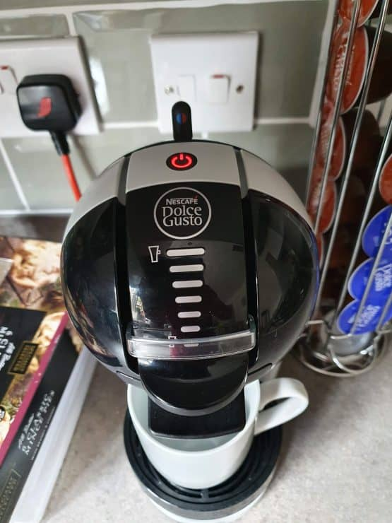 My Dolce Gusto coffee machine with an electric physical switch