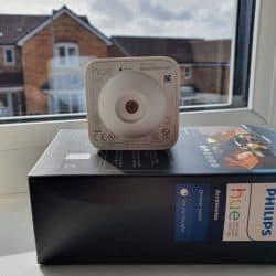 A Hue motion sensor pointed at a window/glass
