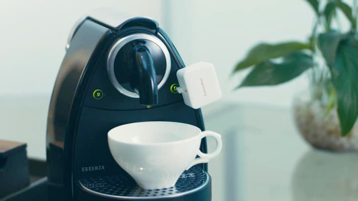SwitchBot Bot turning a coffee machine on