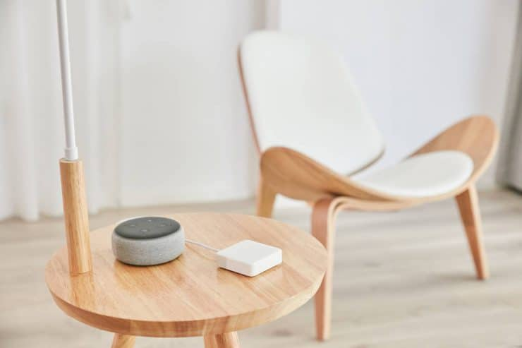 SwitchBot Mini on a table with an Amazon Echo Dot