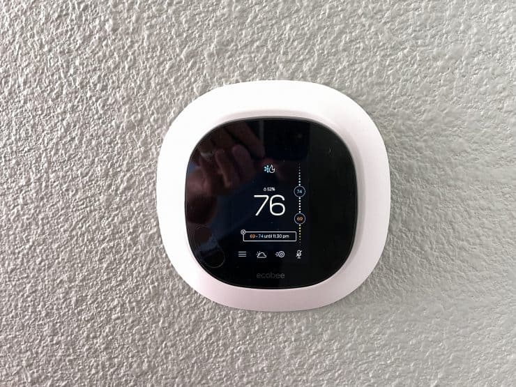 A wall mounted ecobee smart thermostat