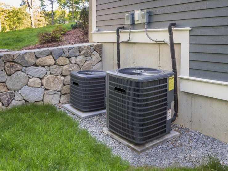 Outdoor HVAC units with fans at the top