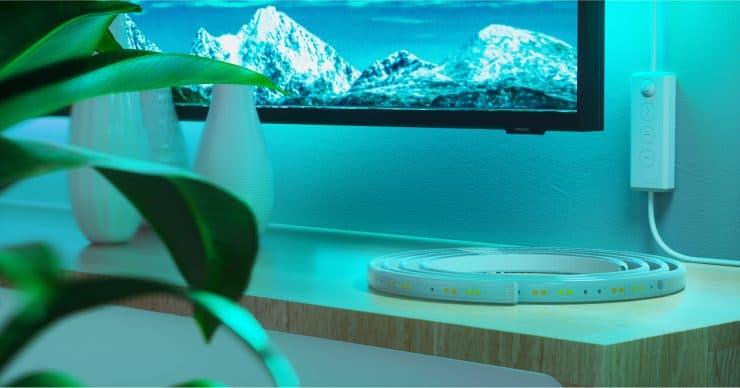 A Nanoleaf Essentials light strip near a TV