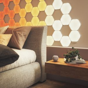Various Nanoleaf shapes on bedroom feature wall with HomePod Mini